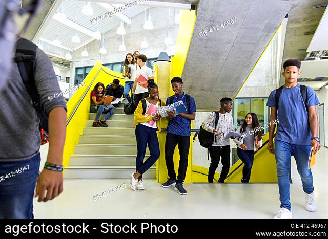 Junior high students hanging out on stairs
