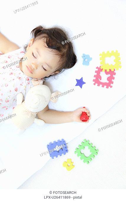 Girl sleeping with stuffed animal
