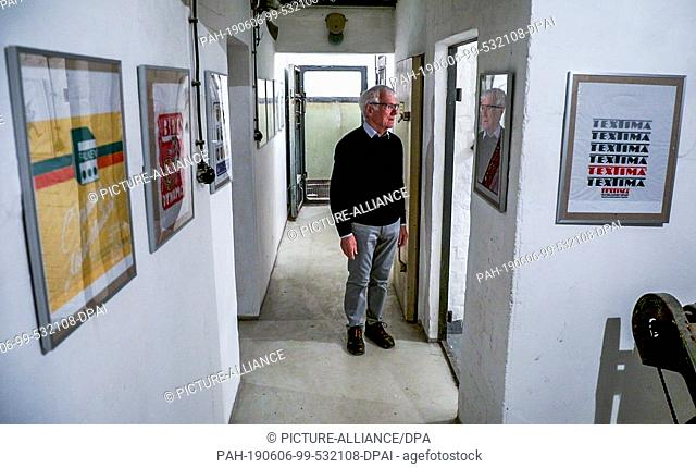 04 June 2019, Mecklenburg-Western Pomerania, Zurow: Dieter Luchs, a collector of GDR shopping bags, stands in a corridor of a former GDR bunker