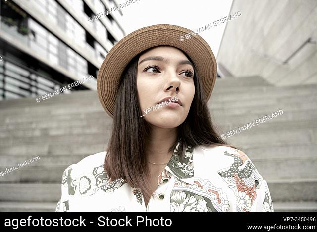 Portrait of woman wearing hat. Munich, Germany