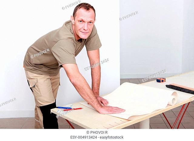 Manual worker wallpapering