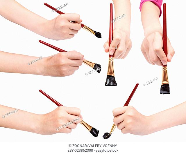 set of hands with art paintbrushes with black tips