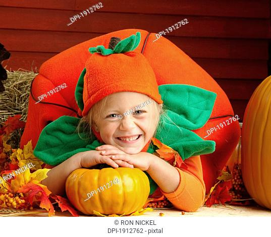 a girl in a pumpkin costume, three hills, alberta, canada