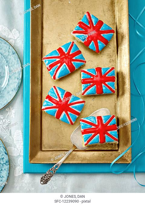Union Jack cakes on a golden cake tray (seen from above)