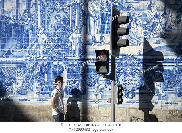 Traditional, blue glazed, dececorated tiles, azulejos, on the exterior of Capela das Almas church, in the centre of Porto, Portugal