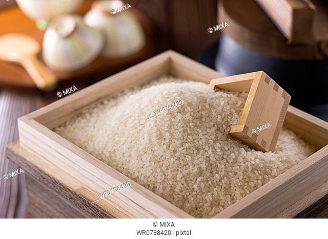Rice and Measuring Cup in Box