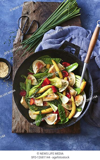 Pork dumpling and Asian greens stir-fry