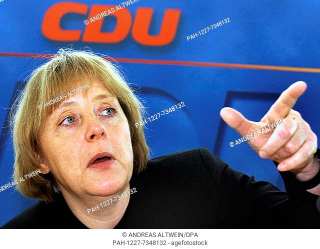 (dpa) - Angela Merkel, chairman of the German Christian Democratic Party CDU, speaks at a party meeting in Berlin, 18 March 2002