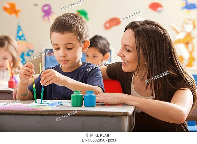 Teacher with children 4-5, 6-7 during art classes
