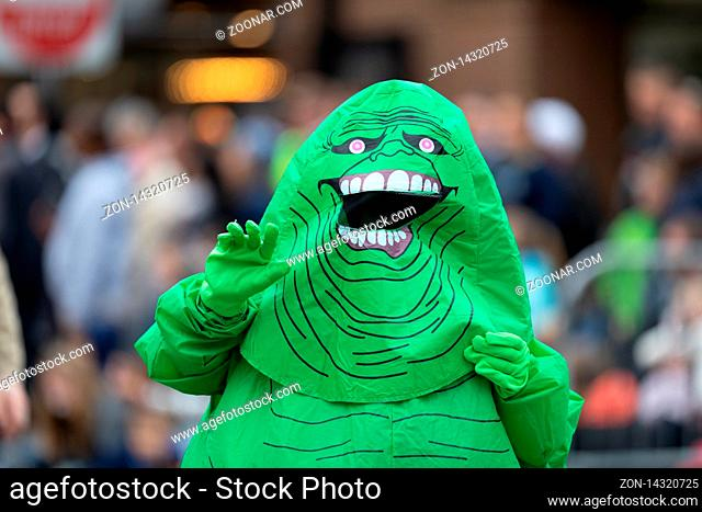 Holland, Michigan, USA - May 11, 2019: Tulip Time Parade, People dress up as Ghostbusters, promoting the Tulip City Ghostbusters during the parade