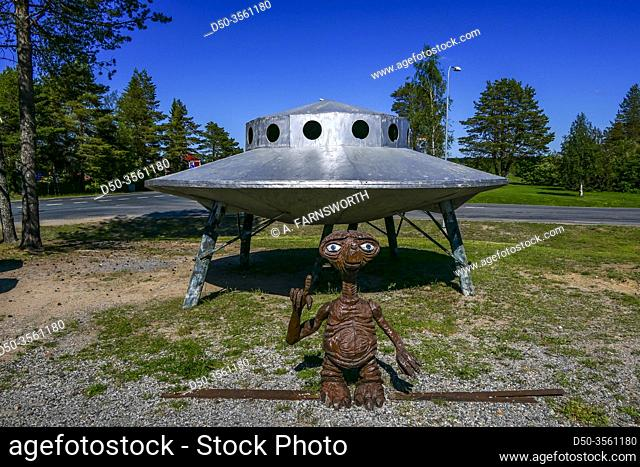 Haparanda, Sweden A small spaceship and an alien on the side of the road at a store selling military surplus