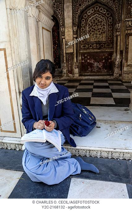 India, Dehradun. Young Female Student Studying at the Durbar Shri Guru Ram Rai Ji Maharaj, a Sikh Temple Built in 1707