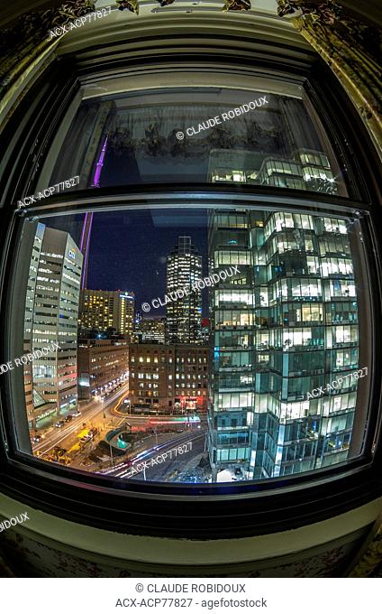 Hotel room window over looking Downtown Toronto and the CN Tower at night, Toronto, Ontario, Canada