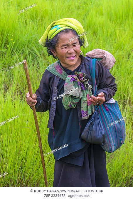 Burmese farmer working on a field in Shan state Myanmar