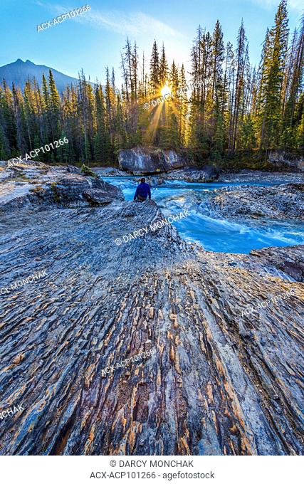 Enjoying sunrise at the Natural Bridge, Kicking Horse River, Yoho Nat'l Park