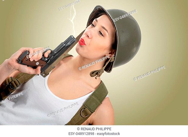 a pretty young woman dressed in ww2 american military uniform with