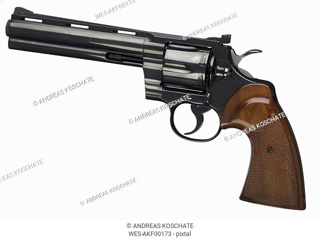 Close up of revolver against white background