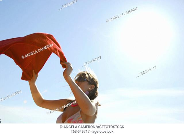 girl/woman 20 yrs old on beach with red towel