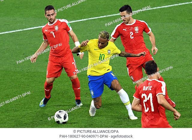 27 June 2018, Russia, Moscow: Soccer, World Cup, Serbia vs Brazil, group E, at the Spartak-Stadium: Serbia's Andrija Zivkovic (L-R) Antonio Rukavina and Nemanja...