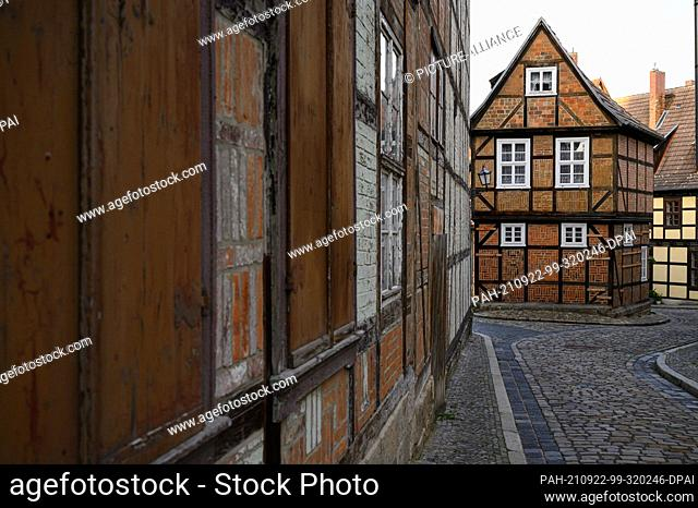 31 August 2021, Saxony-Anhalt, Quedlinburg: View of the facades of the half-timbered houses in the old town of the Unesco World Heritage city