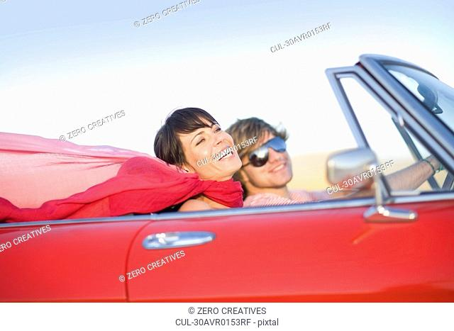 Woman and man in a convertible