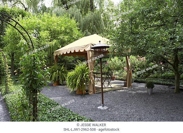 GAZEBOS: Garden, patio angled view of fabric gazebo, two large boston ferns