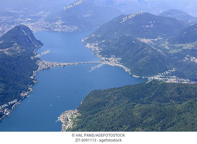 aerial shot, from a small plane, of dam bridge on Lugano lake , shot on a bright early summer day at Melide, Ticino, Switzerland