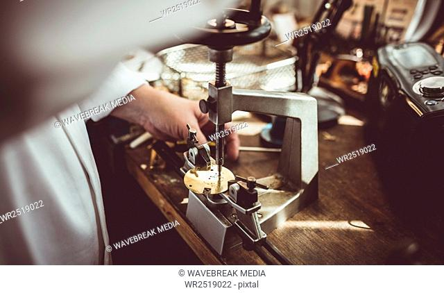 Mid section of horologist using a horological milling machine