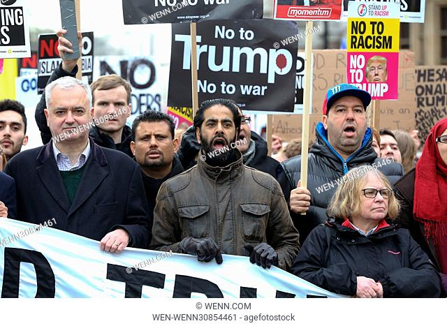 Demonstrators march from London's US Embassy to Downing Street following President Donald Trump's banning of people from seven predominately Muslim countries...