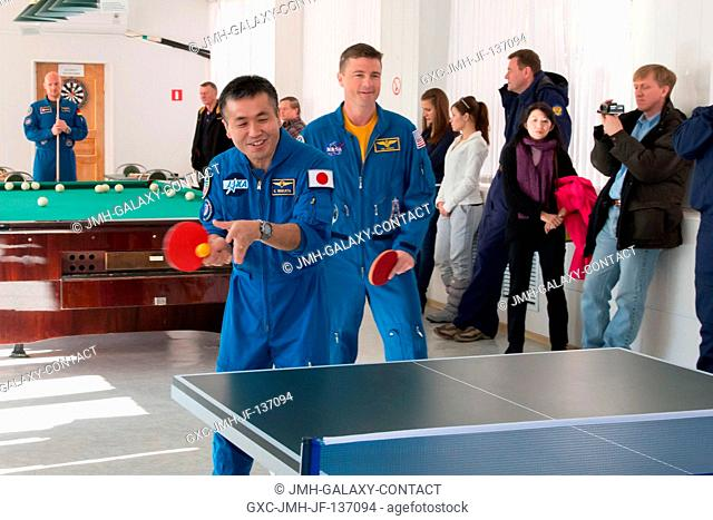 With backup crew member and game partner Reid Wiseman (right) of NASA looking on, prime Expedition 38 Flight Engineer Koichi Wakata of the Japan Aerospace...