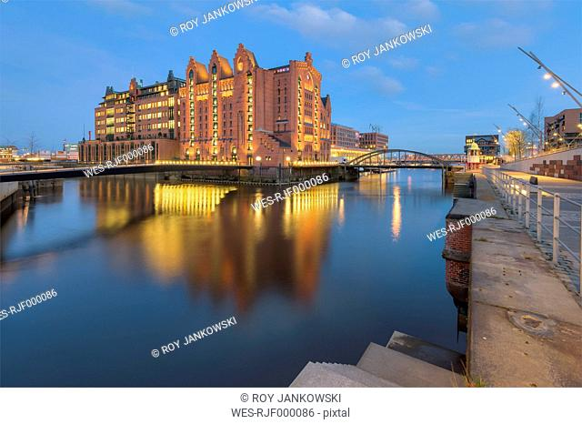 Germany, Hamburg, View of the International Maritime Museum at the Brooktorhafen after sunset
