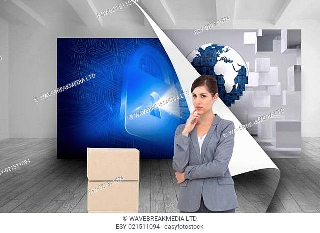 Composite image of thoughtful businesswoman posing with cardboard boxes