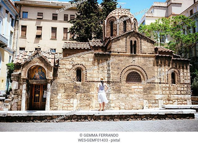 Greece, Athens, woman enjoying the architecture of Church of Panaghia Kapnikarea