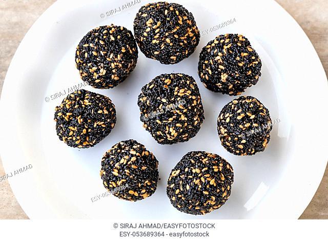 Til ke laddu or Sesame laddu isolated on a white background. Indian sweet