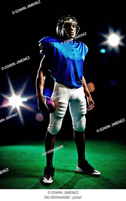 Full length portrait of american football player