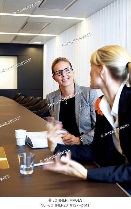 Businesswomen talking in conference room
