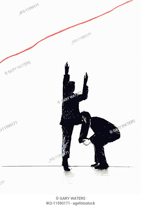 Businessman lifting co-worker up toward ascending red line