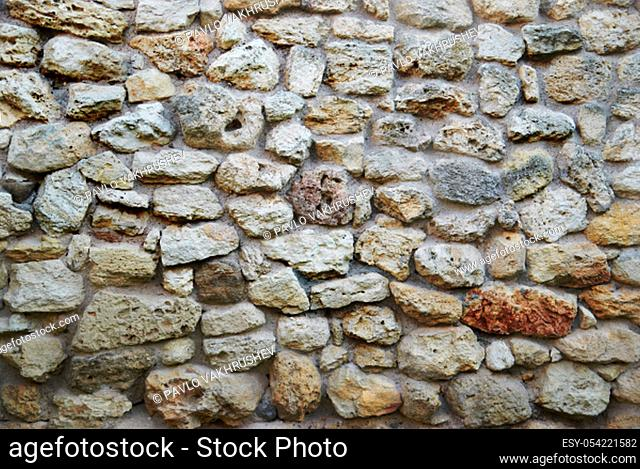 Old yellow stone wall from ancient bricks. Texture for background