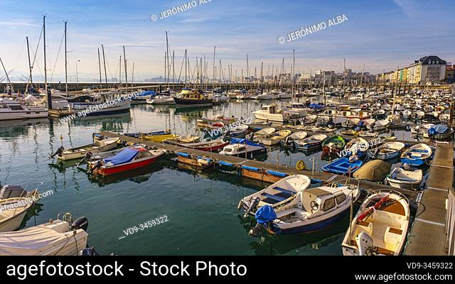 Panoramic harbor view. Boats at Puerto Chico marina and city of Santander, Cantabrian Sea. Cantabria, north Spain. Europe