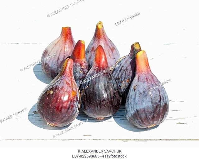 Fresh fig fruits on white wooden background