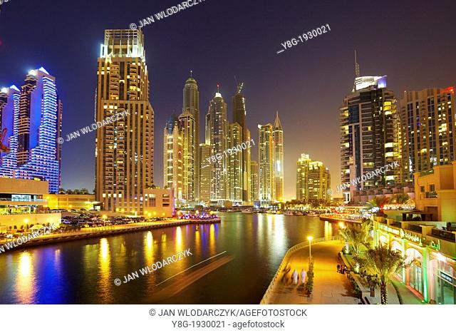 Dubai Marina by night, modern skyscrapers on the canal, Dubai, United Arab Emirates