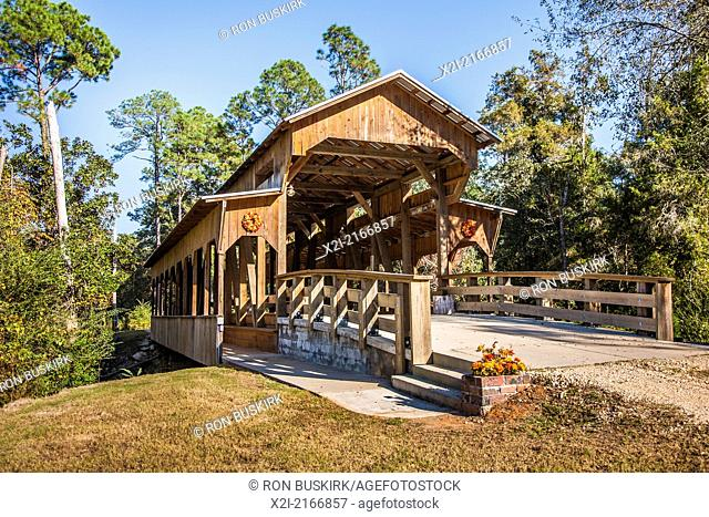 Claude Price uses his self-built covered bridge in Elberta, Alabama to raise funds for St. Mary's Home in Mobile