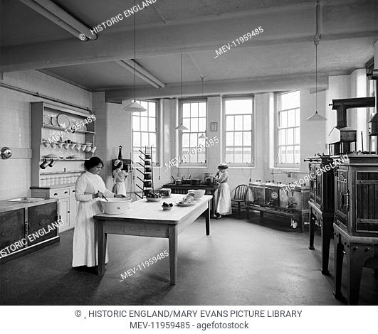 St Andrew's Hospital, Dollis Hill, London. Three female staff working in the kitchen. The hospital was built by the Diocese of Westminster in 1912 for paying...