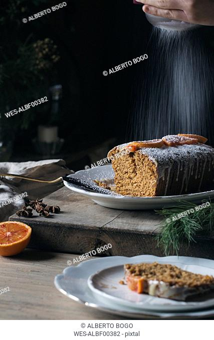 Woman preparing home-baked Christmas cake