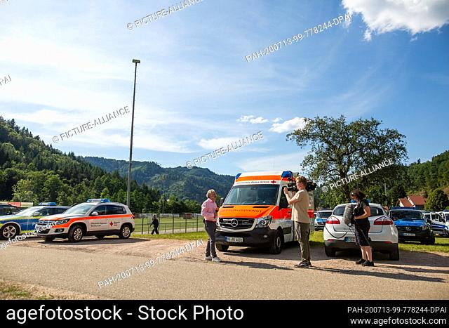 13 July 2020, Baden-Wuerttemberg, Oppenau: A media representative and his camera team report on the state of affairs near the athletes' home