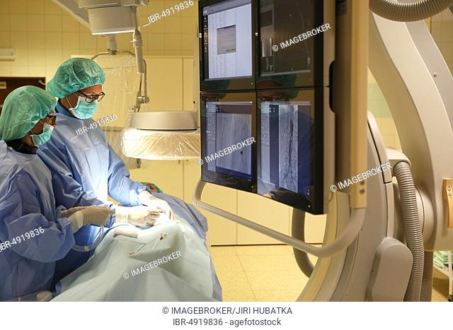 Interventional radiology, doctor with nurse during surgery, Karlovy Vary, Czech Republic, Europe