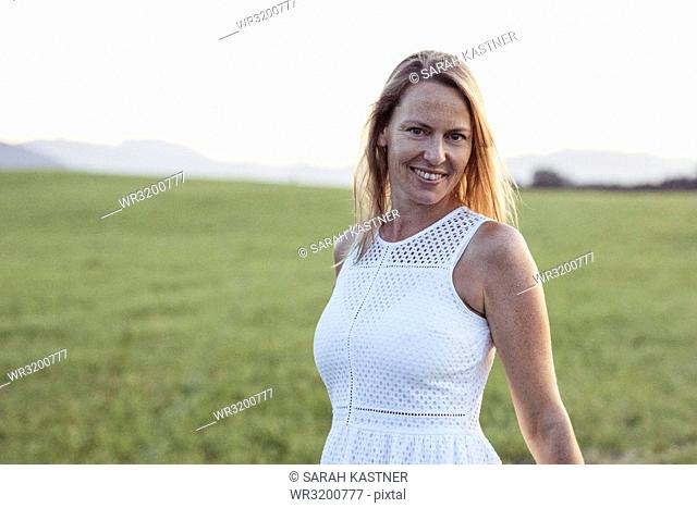 Portrait of a woman on a meadow