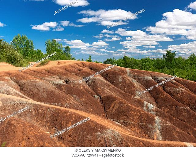 Cheltenham Badlands Ontario Canada summertime scenic. Martian like landscape formed by red and gray eroded clay