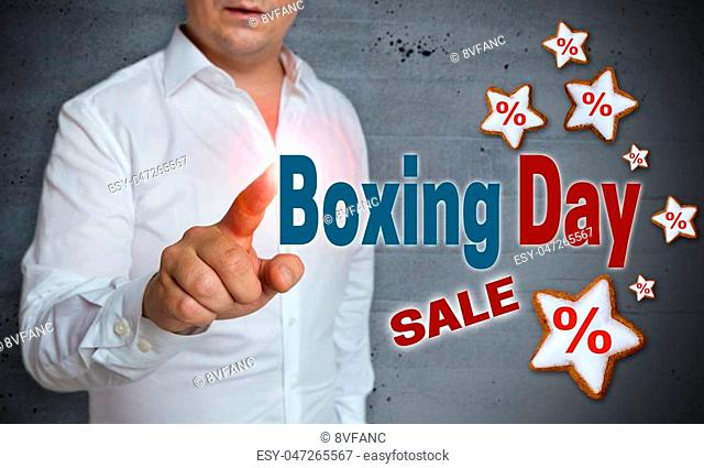 Boxing Day Sale touchscreen is operated by man