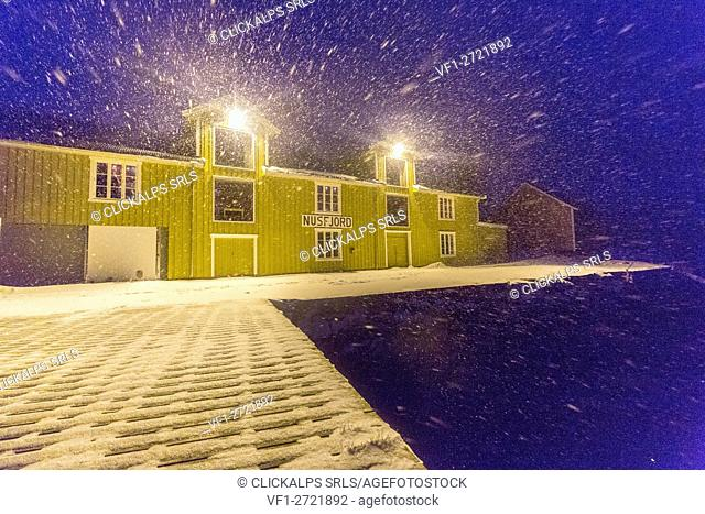 A blizzard hits the fishing village of Nusfjord at dusk Lofoten Islands Nordland County Norway Europe